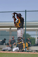 Pittsburgh Pirates catcher Deon Stafford (15) during a Minor League Spring Training game against the Baltimore Orioles on April 21, 2021 at Pirate City in Bradenton, Florida.  (Mike Janes/Four Seam Images)