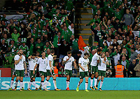 James McClean of Ireland (R) is mobbed by team mates celebrating his opening goal during the FIFA World Cup Qualifier Group D match between Wales and Republic of Ireland at The Cardiff City Stadium, Wales, UK. Monday 09 October 2017