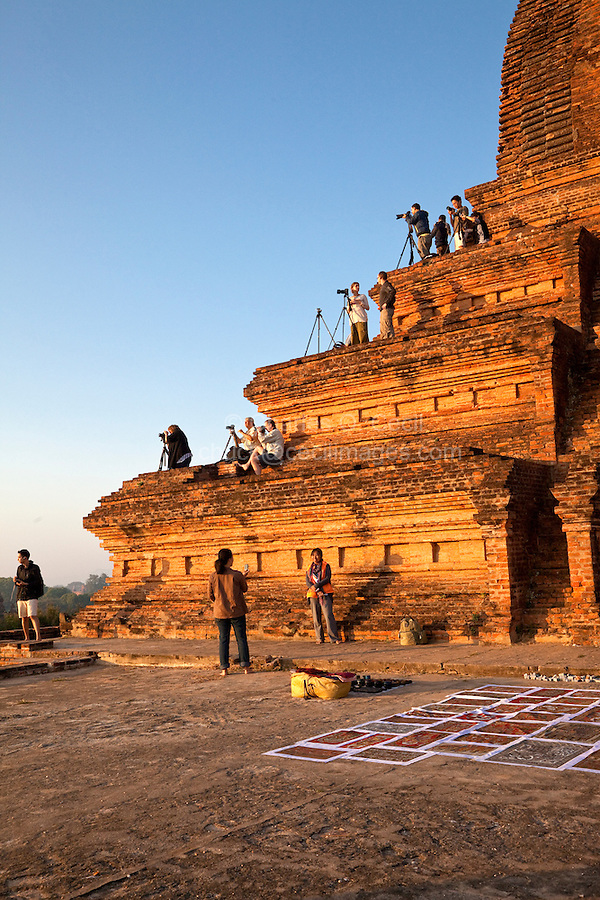 Myanmar, Burma. Bagan.  Photographers on Temple Platforms for Morning Sunrise.