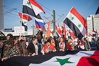 """250 bis 300 Menschen demonstrierten am Samstag den 31. Oktober 2015 in Berlin fuer die Unterstuetzung des syrischen Diktators Assad durch Russland. Sie trugen Fahnen Syriens, der ehemaligen Sowietunion, Russlands, Nordkoreas, der DDR, des Iran und Venezuelas, die sich """"alle zusammen gegen den Imperialismus zur Wehr setzen"""" wuerden. Russlands Praesident Putin wurde ausdruecklich fuer sein Militaerengagement gedankt, das Eingreifen der USA verurteilt.<br /> 31.10.2015, Berlin<br /> Copyright: Christian-Ditsch.de<br /> [Inhaltsveraendernde Manipulation des Fotos nur nach ausdruecklicher Genehmigung des Fotografen. Vereinbarungen ueber Abtretung von Persoenlichkeitsrechten/Model Release der abgebildeten Person/Personen liegen nicht vor. NO MODEL RELEASE! Nur fuer Redaktionelle Zwecke. Don't publish without copyright Christian-Ditsch.de, Veroeffentlichung nur mit Fotografennennung, sowie gegen Honorar, MwSt. und Beleg. Konto: I N G - D i B a, IBAN DE58500105175400192269, BIC INGDDEFFXXX, Kontakt: post@christian-ditsch.de<br /> Bei der Bearbeitung der Dateiinformationen darf die Urheberkennzeichnung in den EXIF- und  IPTC-Daten nicht entfernt werden, diese sind in digitalen Medien nach §95c UrhG rechtlich geschuetzt. Der Urhebervermerk wird gemaess §13 UrhG verlangt.]"""