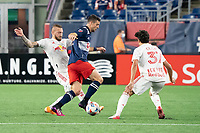 FOXBOROUGH, MA - MAY 22: Daniel Royer #77 of New York Red Bulls and Caden Clark #37 of New York Red Bulls come in to tackle Matt Polster #8 of New England Revolution during a game between New York Red Bulls and New England Revolution at Gillette Stadium on May 22, 2021 in Foxborough, Massachusetts.