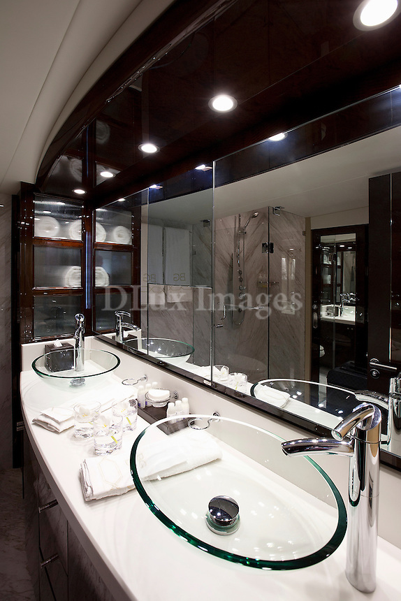 luxury boat bathroom<br /> <br /> A 78 foot Lazzara yacht owned by a well known venture capitalist and tv personality.  The luxury yacht is was decorated in all white with accents of grey by interior designer /architect, Dee Dee Eustace of Taylor Hannah Architect Inc.