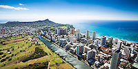 An aerial shot of Waikiki Strip on O'ahu, with Diamond Head and the Ala Wai Golf Course on the left.