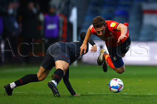 31st October 2020; Kenilworth Road, Luton, Bedfordshire, England; English Football League Championship Football, Luton Town versus Brentford; Tom Lockyer of Luton Town collides with Sergi Canos of Brentford as both players go down