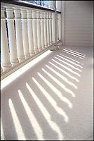 Shadows on snowy porch<br />