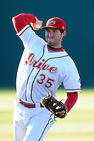 First baseman Jantzen Witte (35) of the Greenville Drive warms up before a game against the Charleston RiverDogs on Wednesday, April 16, 2014, at Fluor Field at the West End in Greenville, South Carolina. Charleston won, 8-7. (Tom Priddy/Four Seam Images)