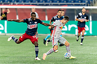FOXBOROUGH, MA - AUGUST 29: Benjamin Mines #17 of New York Red Bulls brings the ball forward as Cristian Penilla #70 of New England Revolution defends during a game between New York Red Bulls and New England Revolution at Gillette Stadium on August 29, 2020 in Foxborough, Massachusetts.