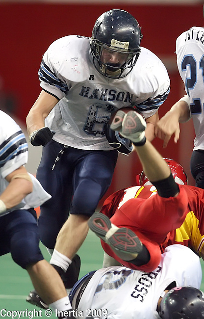 VERMILLION, SD - NOVEMBER 13: Austin Letcher #6 of Hanson tries to squeese through a hole in the line against Avon in the fourth quarter of the South Dakota Class 9A Championship game Friday, November 13, 2009 at the DakotaDome in Vermillion, SD. (Photo by Dave Eggen/Inertia)