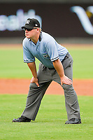 Umpire Garrett Corl handles the calls on the bases during the Carolina League game between the Wilmington Blue Rocks and the Winston-Salem Dash at BB&T Ballpark on June 10, 2012 in Winston-Salem, North Carolina.  The Dash defeated the Blue Rocks 2-0.  (Brian Westerholt/Four Seam Images)