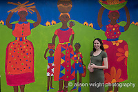 Africa, Swaziland, Malkerns.Nest organization artisan project, partnering with Gone Rural & local artisans to help market their products to global markets and better sustain their local community. Rebecca vanBergen from Nest in front of mural.