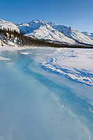 Overflow ice on the Koyukuk River, Shell mountain of the Brooks Range in the distance.