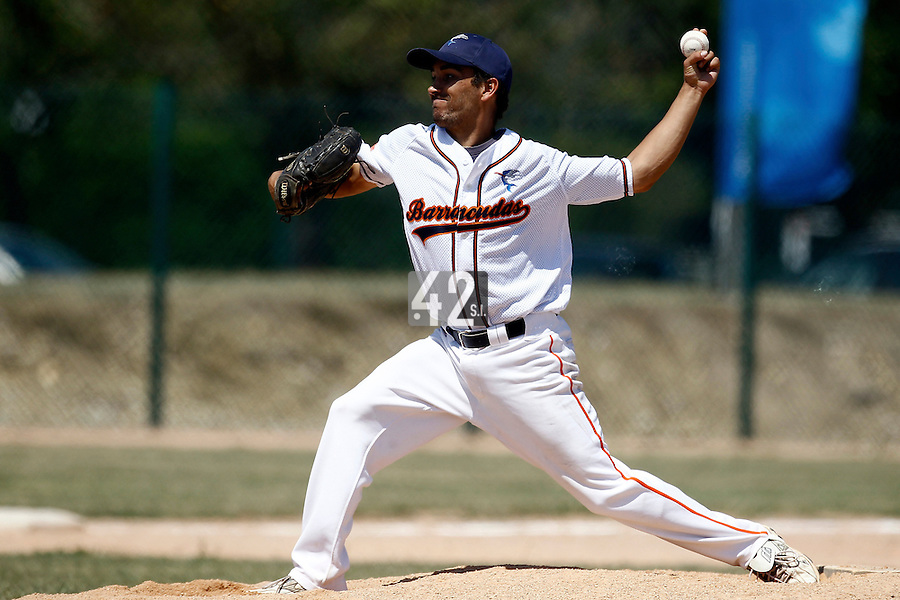 15 July 2011: Thomas Meley of Montpellier pitches against Montigny during the 2011 Challenge de France match won 10-7 by the Montpellier Barracudas over Montigny Cougars, in Les Andelys, near Rouen, France.