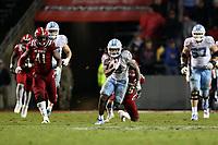 RALEIGH, NC - NOVEMBER 30: Michael Carter #8 of the University of North Carolina runs the ball during a game between North Carolina and North Carolina State at Carter-Finley Stadium on November 30, 2019 in Raleigh, North Carolina.