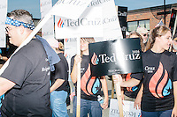 Supporters of Republican presidential candidate Ted Cruz prepare to march in the Labor Day parade in Milford, New Hampshire. Though Cruz did not march in the parade,  Republican candidates John Kasich, Carly Fiorina, and Lindsey Graham, and Democratic candidate Bernie Sanders did in the parade.