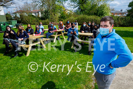 Teacher Paddy O'Shea (front right) with Presentation Secondary school students enjoy the outdoors at the school on the new benches.