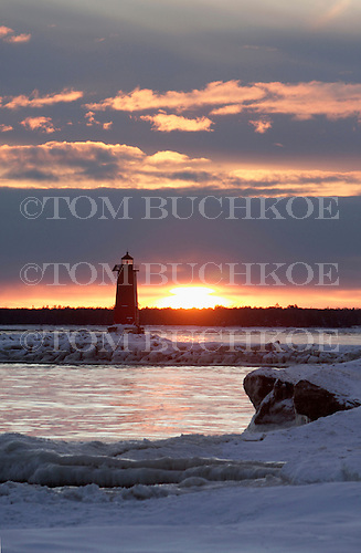 Sunset  behind the Manistique lighthouse, in Michigan's Upper Peninsula on Lake Michigan.