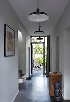 The house has been designed with style and simplicity with dark grey waxed concrete flooring uniting the rooms