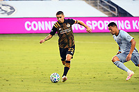 KANSAS CITY, UNITED STATES - AUGUST 25: Matias Vera #22 of Houston Dynamo with the ball against Roger Espinoza #15 of Sporting Kansas City  a game between Houston Dynamo and Sporting Kansas City at Children's Mercy Park on August 25, 2020 in Kansas City, Kansas.
