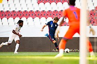 GUADALAJARA, MEXICO - MARCH 28: Tanner Tessmann #11 of the United States sends a cross ball into the box during a game between Honduras and USMNT U-23 at Estadio Jalisco on March 28, 2021 in Guadalajara, Mexico.