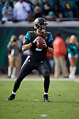 Jacksonville Jaguars quarterback Blake Bortles (5) looks to pass in the third quarter during an NFL Wild-Card football game against the Buffalo Bills, Sunday, January 7, 2018, in Jacksonville, Fla.  (Mike Janes Photography)