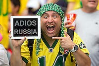 A Brazil fan with a ADIOS RUSSIA sign