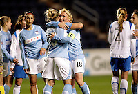 Chicago Red Stars midfielder Frida Ostberg (18) gets a hug from forward Ella Masar (3) after the Red Star victory.  The Chicago Red Stars defeated the Boston Breakers 4-0 at Toyota Park in Bridgeview, IL on April 25, 2009.