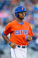 Florida Gators outfielder Buddy Reed (23) walks to first base against the Virginia Cavaliers in Game 13 of the NCAA College World Series on June 20, 2015 at TD Ameritrade Park in Omaha, Nebraska. The Cavaliers beat the Gators 5-4. (Andrew Woolley/Four Seam Images)