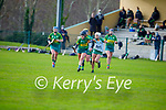 Jessica Fitzell of Kerry takes to the ground running as   Claire Coffey of Meath puts in a tackle for possession in the Camogie Intermediate Championship