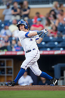 Taylor Motter (11) of the Durham Bulls follows through on his swing against the Scranton/Wilkes-Barre RailRiders at Durham Bulls Athletic Park on May 15, 2015 in Durham, North Carolina.  The RailRiders defeated the Bulls 8-4 in 11 innings.  (Brian Westerholt/Four Seam Images)