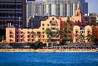 "The fabulous Royal Hawaiian Hotel or """"pink palace"""", an historic landmark in Waikiki Beach, viewed from the beautiful blue Pacific ocean."