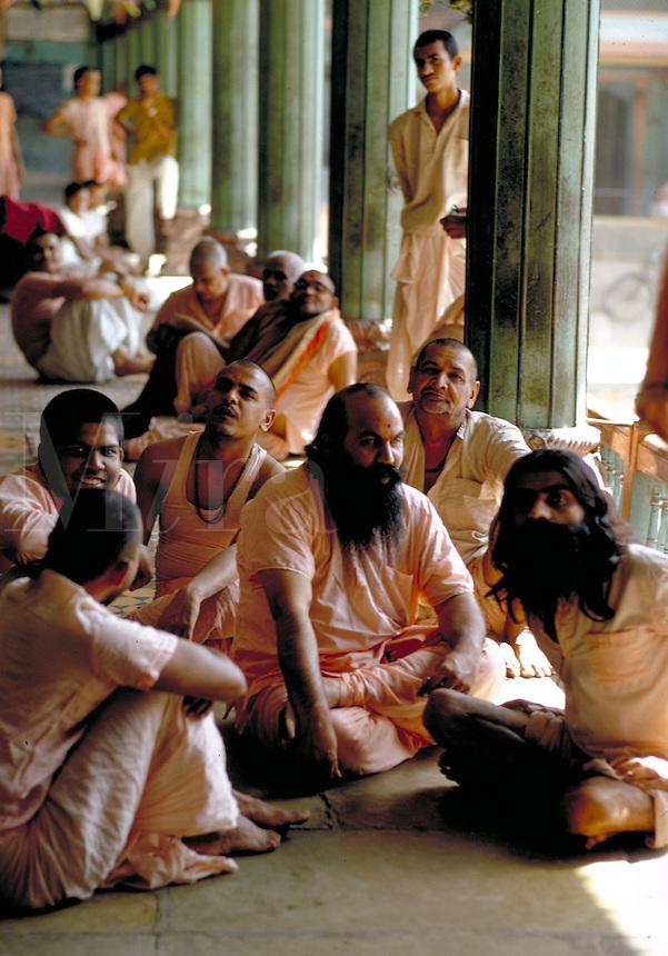 Group of Holy Men sitting together during a Hindu Festival in Ahmadabad, India. Ahmadabad is the capital of Gujarat state, NW India, on the Sabarmati River. Ahmadabad, India.