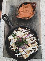 Chilaquiles, beans, wooden board, iron skillet, food,<br /> <br /> <br /> Chilaquiles , frijoles, tabla de madera, sartén de hierro , comida