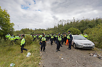 Pictured: Police officers on site. Monday 31 August 2020<br /> Re: Around 70 South Wales Police officers executed a dispersal order at the site of an illegal rave party, where they confiscated sound gear used by the organisers in woods near the village of Banwen, in south Wales, UK.