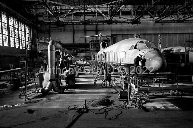 "Samara, Russia  .October 1997.""Aviacor""-Russian joint stock company produces and repairs TU-154M passenger planes. A worker repairs a plane in one of the only factory hangers which still operates. This Russian industry is in serious trouble today.."