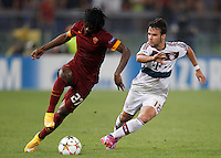 Calcio, Champions League, Gruppo E: Roma vs Bayern Monaco. Roma, stadio Olimpico, 21 ottobre 2014.<br /> Roma's Gervinhois challenged by Bayern's Juan Bernat during the Group E Champions League football match between AS Roma and Bayern at Rome's Olympic stadium, 21 October 2014.<br /> UPDATE IMAGES PRESS/Isabella Bonotto