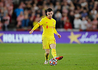 25th September 2021; Brentford Community Stadium, London, England; Premier League Football Brentford versus Liverpool; Andrew Robertson of Liverpool passing the ball into midfield