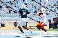 CHAPEL HILL, NC - OCTOBER 10: Dyami Brown #2 of North Carolina gets behind Armani Chatman #27 of Virginia Tech and catches a 37-yard touchdown pass during a game between Virginia Tech and North Carolina at Kenan Memorial Stadium on October 10, 2020 in Chapel Hill, North Carolina.