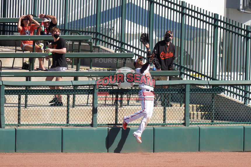 Baltimore Orioles outfielder Yusniel Diaz (23) attempts to catch a home run hit by Todd Frazier (not shown) during a Major League Spring Training game against the Pittsburgh Pirates on February 28, 2021 at Ed Smith Stadium in Sarasota, Florida.  (Mike Janes/Four Seam Images)