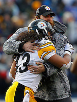 ORCHARD PARK, NY - NOVEMBER 28:  Brett Keisel #99 of the Pittsburgh Steelers hugs teammate Troy Polamalu #43 after catching an interception against the Buffalo Bills during the game on November 28, 2010 at Ralph Wilson Stadium in Orchard Park, New York.  (Photo by Jared Wickerham/Getty Images)