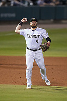 Charlotte Knights third baseman Jake Burger (9) makes a throw to first base against the Norfolk Tides at Truist Field on May 14, 2021 in Charlotte, North Carolina. (Brian Westerholt/Four Seam Images)