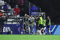 CARY, NC - DECEMBER 13: Foster McCune #22 of Georgetown University celebrates his goal with Derek Dodson #9 and other teammates during a game between Stanford and Georgetown at Sahlen's Stadium at WakeMed Soccer Park on December 13, 2019 in Cary, North Carolina.