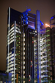 The Lloyds Building in the City of London at night.