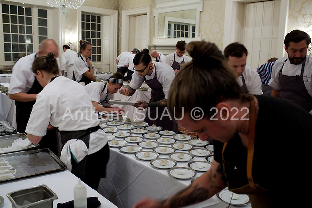 Charleston, South Carolina<br /> October 24, 2013<br /> <br /> 17 internationally renowned chefs, attending the Cook It Raw event in Charleston, put the final touches on their plates and serve them to a select crowd for dinner at McCrady's restaurant. <br /> <br /> Foreground right is chef Brandon Baltzley from the restaurant TMIP in Laporte County, Indiana along with chef April Bloomfield from restaurant The Spotted Pig, in New York City, Sasu Laukkonen chef and sommerier at restaurant Eira in Helsinki, Findland and James Lowe chef at restaurant The Young Turks in London, England.