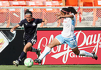 Lisa DeVanna #17 of Washington Freedom breaks away from Chioma Igwe #12 of Chicago Red Stars during a WPS match at RFK Stadium on June 13 2009, in Washington D.C.
