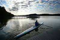Fred Ridgeway of Springdale prepares Wednesday, Sept. 8, 2021, to exit his scull and climb onto the dock after a session of rowing at Lake Fayetteville. Ridgeway is a member of the Rowing Club of Northwest Arkansas and rows twice weekly on the lake. Visit nwaonline.com/210909Daily/ for today's photo gallery.<br /> (NWA Democrat-Gazette/Andy Shupe)