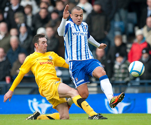 GLASGOW, SCOTLAND - JANUARY 28: Ayr's Michael Moffat and Killie's Ben Gordon during the Scottish Communities Cup Semi Final match between Ayr United and Kilmarnock at Hampden Park on January 28, 2012 in Glasgow, United Kingdom. (Photo by Rob Casey/Getty Images).