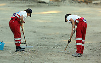 Pictured: Hellenic Red Cross volunteers searching at the farmhouse site in Kos, Greece. Sunday 09 October 2016<br />Re: Police teams led by South Yorkshire Police, searching for missing toddler Ben Needham on the Greek island of Kos have moved to a new area in the field they are searching.<br />Ben, from Sheffield, was 21 months old when he disappeared on 24 July 1991 during a family holiday.<br />Digging has begun at a new site after a fresh line of inquiry suggested he could have been crushed by a digger.