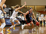 SIOUX FALLS, SD - MARCH 6: Haley Greer #11 of the South Dakota State Jackrabbits drives to the basket against Tylee Irwin #21 of the South Dakota State Jackrabbits during the Summit League Basketball Tournament at the Sanford Pentagon in Sioux Falls, SD. (Photo by Dave Eggen/Inertia)
