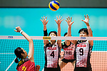 Wing spiker Risa Shinnabe of Japan (C) and Middle blocker Haruyo Shimamura of Japan (R) blocks Wing spiker Ting Zhu of China (L) during the FIVB Volleyball World Grand Prix match between China vs Japan on July 21, 2017 in Hong Kong, China. Photo by Marcio Rodrigo Machado / Power Sport Images