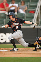 Gary Helmick #6 of the Delmarva Shorebirds follows through on his swing against the Kannapolis Intimidators at Fieldcrest Cannon Stadium May 14, 2010, in Kannapolis, North Carolina.  Photo by Brian Westerholt / Four Seam Images
